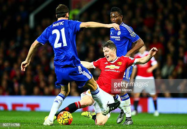 Bastian Schweinsteiger of Manchester United battles for the ball with Nemanja Matic of Chelsea and John Obi Mikel of Chelsea during the Barclays...