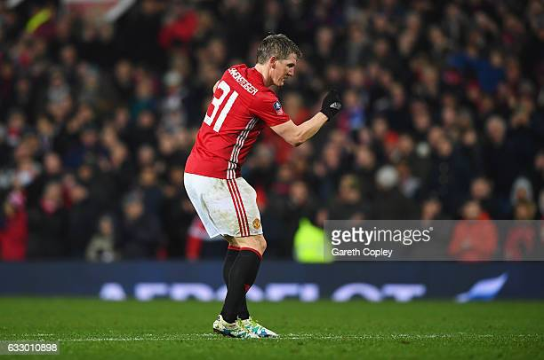 Bastian Schweinsteiger of Manchester United celebrates as he scores their fourth goal during the Emirates FA Cup Fourth round match between...