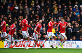 Bastian Schweinsteiger of Manchester United celebrates his team's second goal scored by Troy Deeney of Watford with his team mates during the...
