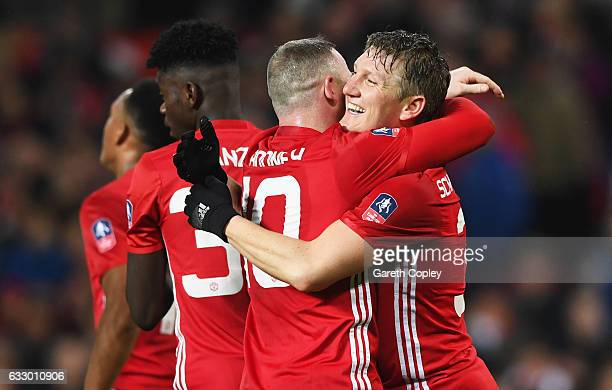 Bastian Schweinsteiger of Manchester United celebrates with Wayne Rooney as he scores their fourth goal during the Emirates FA Cup Fourth round match...