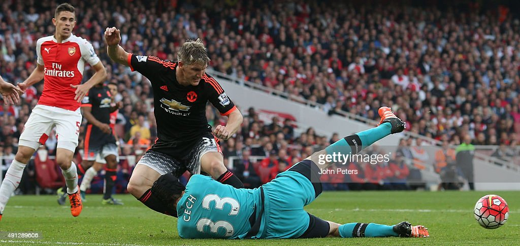 Bastian Schweinsteiger of Manchester United in action with Petr Cech of Arsenal during the Barclays Premier League match between Arsenal and Manchester United at Emirates Stadium on October 4, 2015 in London, England