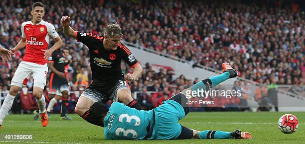 Bastian Schweinsteiger of Manchester United in action with Petr Cech of Arsenal during the Barclays Premier League match between Arsenal and...