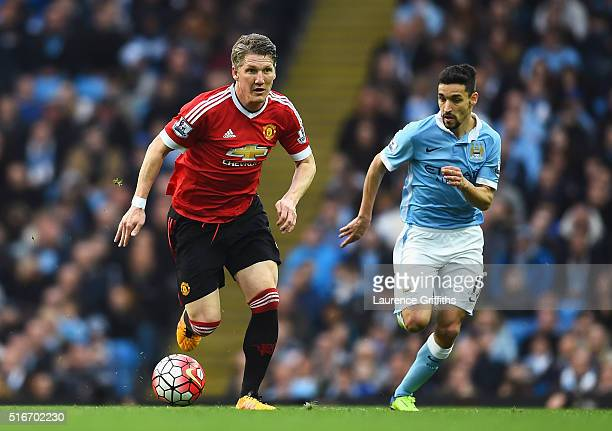 Bastian Schweinsteiger of Manchester United is chased by Jesus Navas of Manchester City during the Barclays Premier League match between Manchester...