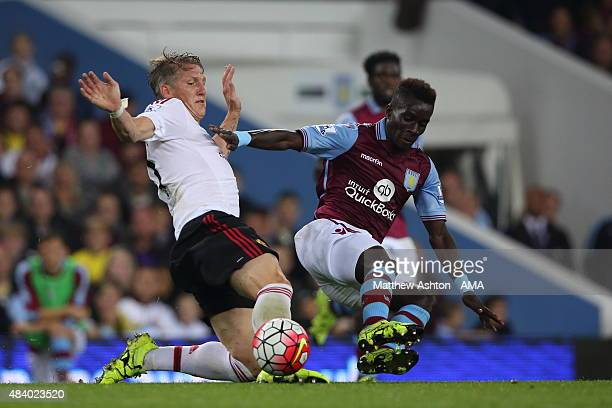 Bastian Schweinsteiger of Manchester United is tackled by Idrissa Gueye of Aston Villa during the Barclays Premier League match between Aston Villa...