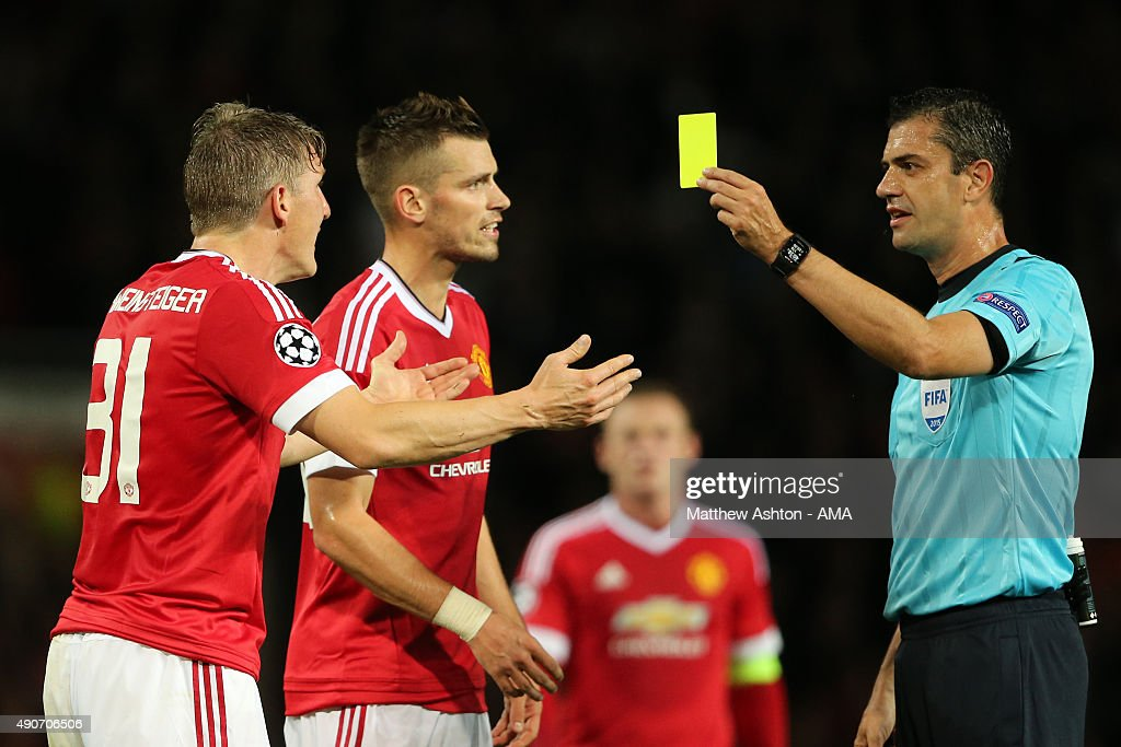Bastian Schweinsteiger of Manchester United reacts as he receives a yellow card during the UEFA Champions League match between Manchester United and Wolfsburg at Old Trafford on September 30, 2015 in Manchester, United Kingdom.