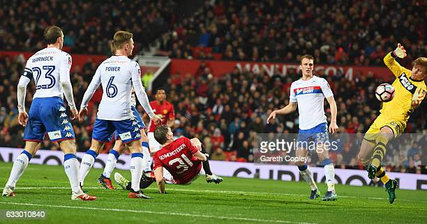Bastian Schweinsteiger of Manchester United scores their fourth goal past goalkeeper Jakob Haugaard of Wigan Athletic during the Emirates FA Cup...