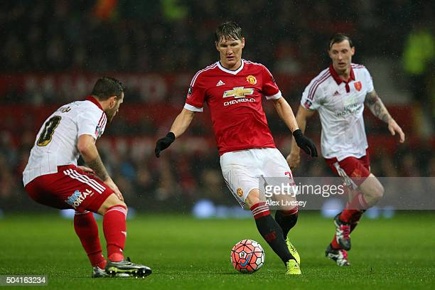 Bastian Schweinsteiger of Manchester United takes on Billy Sharp of Sheffield United during the Emirates FA Cup Third Round match between Manchester...