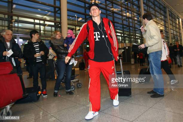 Bastian Schweinsteiger of Muenchen arrives at Munich airport prior to his team's departure to the training camp in Doha on January 2 2012 in Munich...
