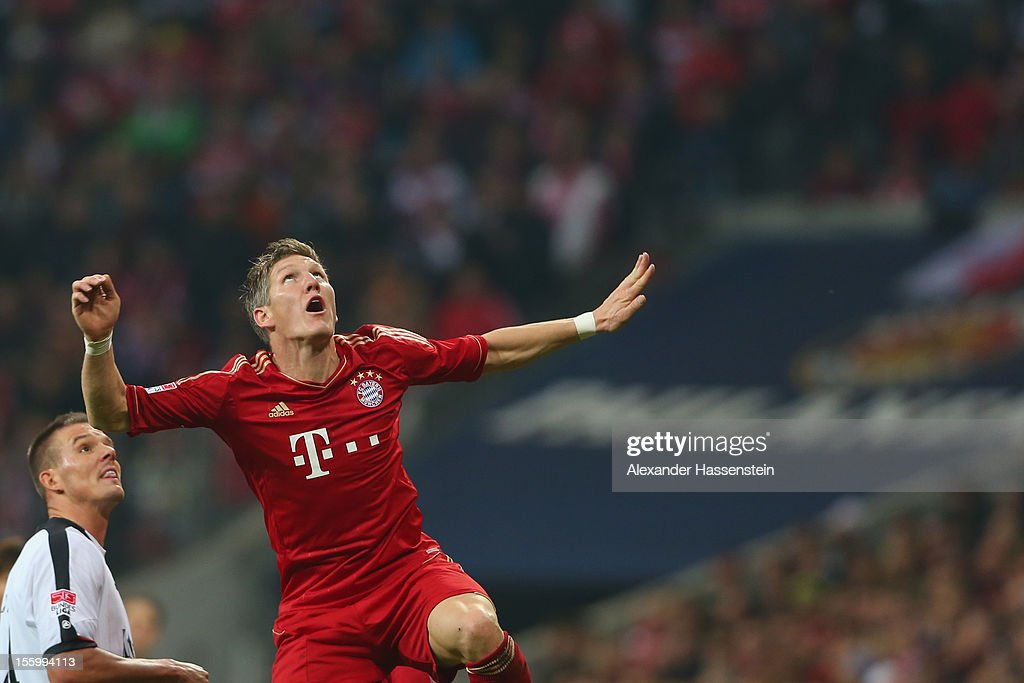 <a gi-track='captionPersonalityLinkClicked' href=/galleries/search?phrase=Bastian+Schweinsteiger&family=editorial&specificpeople=203122 ng-click='$event.stopPropagation()'>Bastian Schweinsteiger</a> (R) of Muenchen battles for the ball with Alex Meier of Frankfurt during the Bundesliga match between FC Bayern Muenchen and Eintracht Frankfurt at Allianz Arena on November 10, 2012 in Munich, Germany.