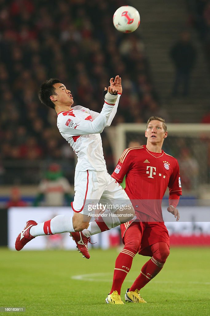 Bastian Schweinsteiger (R) of Muenchen battles for the ball with Shinji Okazaki of Stuttgart during the Bundesliga match between VfB Stuttgart and FC Bayern Muenchen at Mercedes-Benz Arena on January 27, 2013 in Stuttgart, Germany.