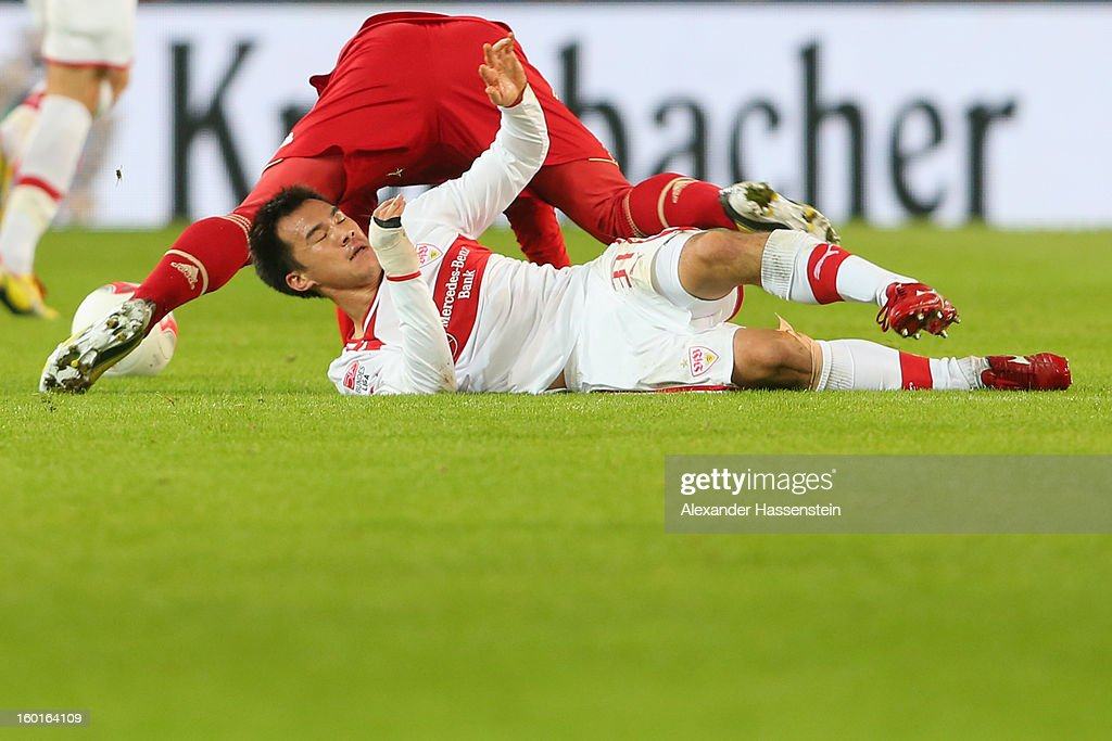 Bastian Schweinsteiger (top) of Muenchen battles for the ball with Shinji Okazaki of Stuttgart during the Bundesliga match between VfB Stuttgart and FC Bayern Muenchen at Mercedes-Benz Arena on January 27, 2013 in Stuttgart, Germany.
