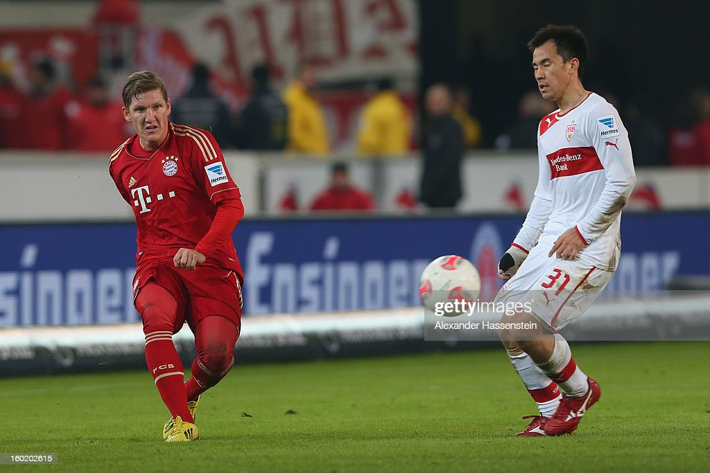 Bastian Schweinsteiger (L) of Muenchen battles for the ball with Shinji Okazaki of Stuttgart during the Bundesliga match between VfB Stuttgart and FC Bayern Muenchen at Mercedes-Benz Arena on January 27, 2013 in Stuttgart, Germany.