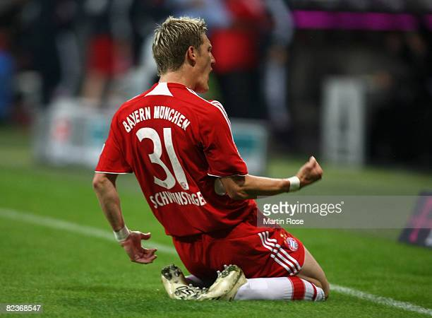 Bastian Schweinsteiger of Muenchen celebrates after scoring the 1st goal during the Bundesliga match between Bayern Muenchen and Hamburger SV at the...