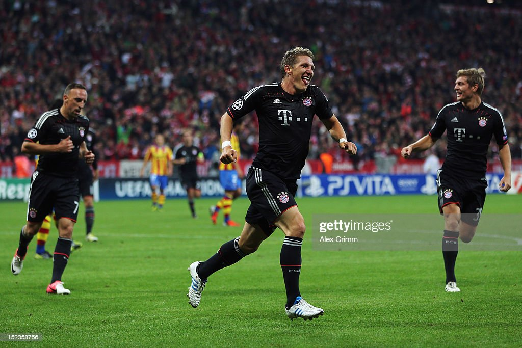 <a gi-track='captionPersonalityLinkClicked' href=/galleries/search?phrase=Bastian+Schweinsteiger&family=editorial&specificpeople=203122 ng-click='$event.stopPropagation()'>Bastian Schweinsteiger</a> (C) of Muenchen celebrates his team's first goal with team mates <a gi-track='captionPersonalityLinkClicked' href=/galleries/search?phrase=Franck+Ribery&family=editorial&specificpeople=490869 ng-click='$event.stopPropagation()'>Franck Ribery</a> (L) and <a gi-track='captionPersonalityLinkClicked' href=/galleries/search?phrase=Toni+Kroos&family=editorial&specificpeople=638597 ng-click='$event.stopPropagation()'>Toni Kroos</a> during the UEFA Champions League group F match between FC Bayern Muenchen and Valencia CF at Allianz Arena on September 19, 2012 in Munich, Germany.
