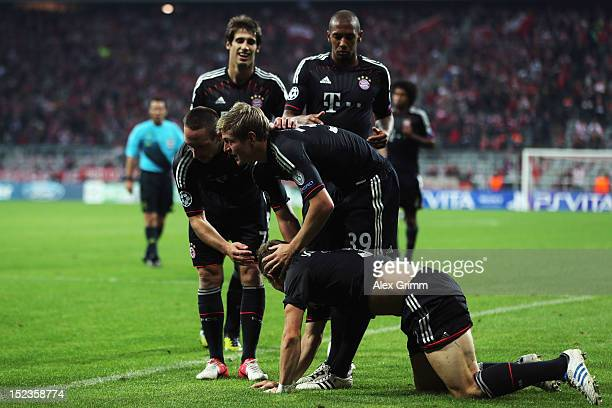 Bastian Schweinsteiger of Muenchen celebrates his team's first goal with team mates Toni Kroos and Franck Ribery during the UEFA Champions League...