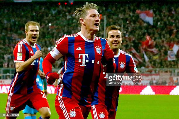 Bastian Schweinsteiger of Muenchen celebrates scoring his team's first goal during the Bundesliga match between FC Bayern Muenchen and 1 FC Koeln at...