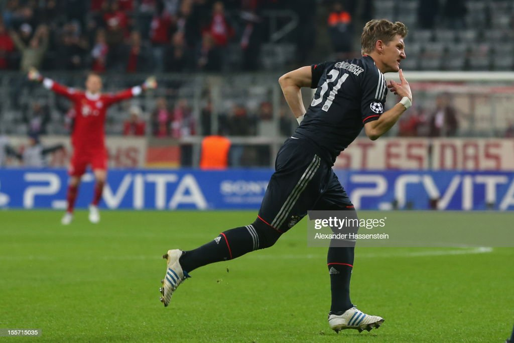 Bastian Schweinsteiger of Muenchen celebrates scoring the opening goal during the UEFA Champions League group F match between FC Bayern Muenchen and...