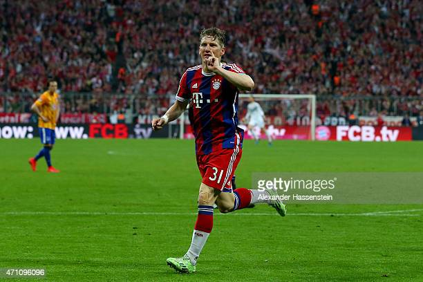 Bastian Schweinsteiger of Muenchen celebrates scoring the opening goal during the Bundesliga match between FC Bayern Muenchen and Hertha BSC Berlin...