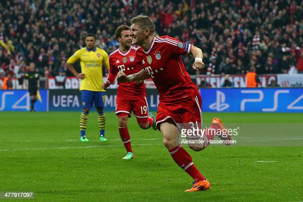 Bastian Schweinsteiger of Muenchen celebrates scoring the opening goal during the UEFA Champions League Round of 16 second leg match between FC...