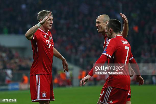 Bastian Schweinsteiger of Muenchen celebrates scoring the opening goal with his team mate Arjen Robben and Franck Ribery during the UEFA Champions...