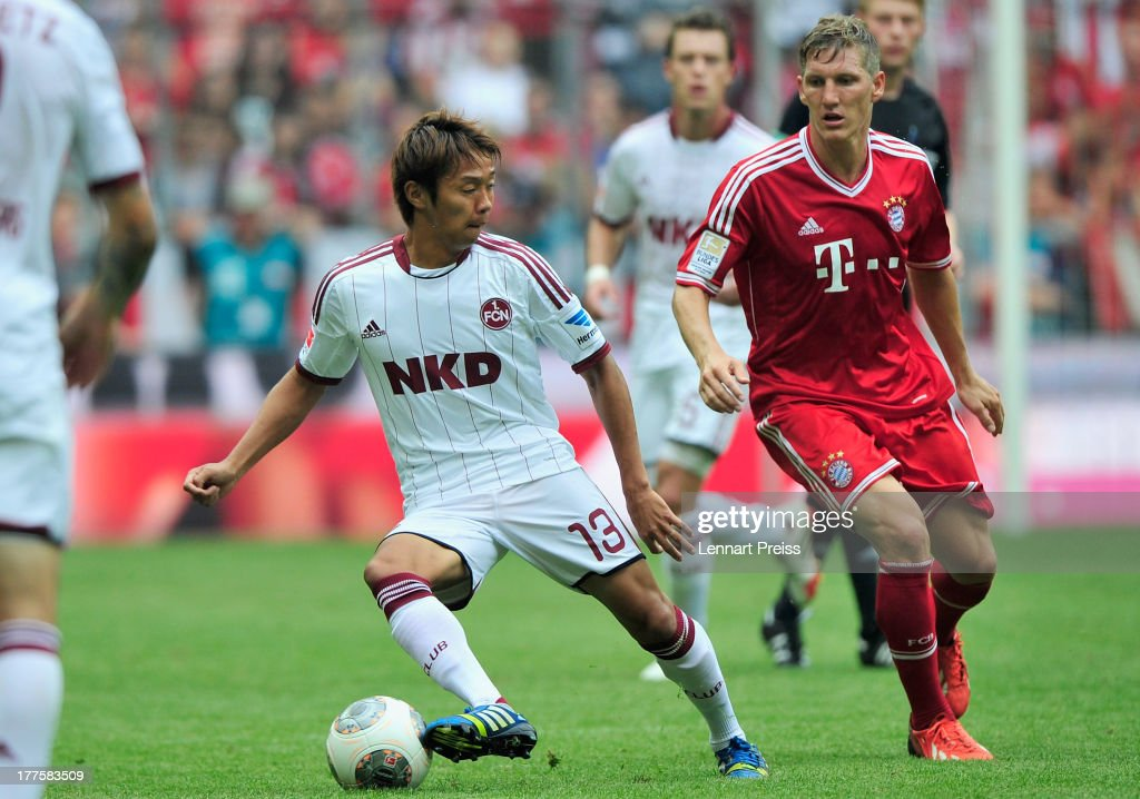 <a gi-track='captionPersonalityLinkClicked' href=/galleries/search?phrase=Bastian+Schweinsteiger&family=editorial&specificpeople=203122 ng-click='$event.stopPropagation()'>Bastian Schweinsteiger</a> (R) of Muenchen challenges <a gi-track='captionPersonalityLinkClicked' href=/galleries/search?phrase=Hiroshi+Kiyotake&family=editorial&specificpeople=7645519 ng-click='$event.stopPropagation()'>Hiroshi Kiyotake</a> of Nuernberg during the Bundesliga match between FC Bayern Muenchen and 1. FC Nuernberg at Allianz Arena on August 24, 2013 in Munich, Germany.