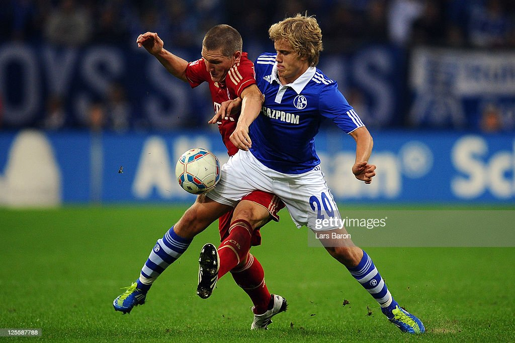 <a gi-track='captionPersonalityLinkClicked' href=/galleries/search?phrase=Bastian+Schweinsteiger&family=editorial&specificpeople=203122 ng-click='$event.stopPropagation()'>Bastian Schweinsteiger</a> of Muenchen challenges <a gi-track='captionPersonalityLinkClicked' href=/galleries/search?phrase=Teemu+Pukki&family=editorial&specificpeople=8055578 ng-click='$event.stopPropagation()'>Teemu Pukki</a> of Schalke during the Bundesliga match between FC Schalke 04 and FC Bayern Muenchen at Veltins Arena on September 18, 2011 in Gelsenkirchen, Germany.