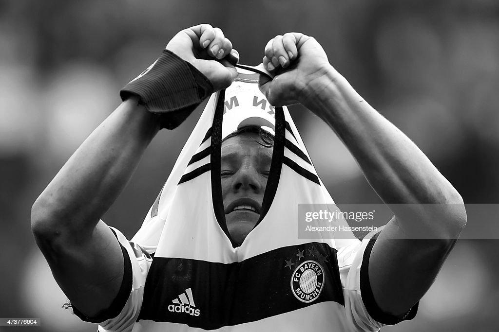 Bastian Schweinsteiger of Muenchen changes his match jersey during the half time break of Bundesliga match between Sport Club Freiburg and FC Bayern Muenchen at Schwarzwald-Stadion on May 16, 2015 in Freiburg im Breisgau, Germany.