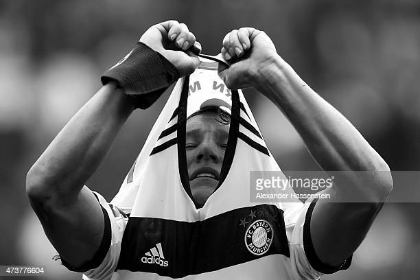 Bastian Schweinsteiger of Muenchen changes his match jersey during the half time break of Bundesliga match between Sport Club Freiburg and FC Bayern...