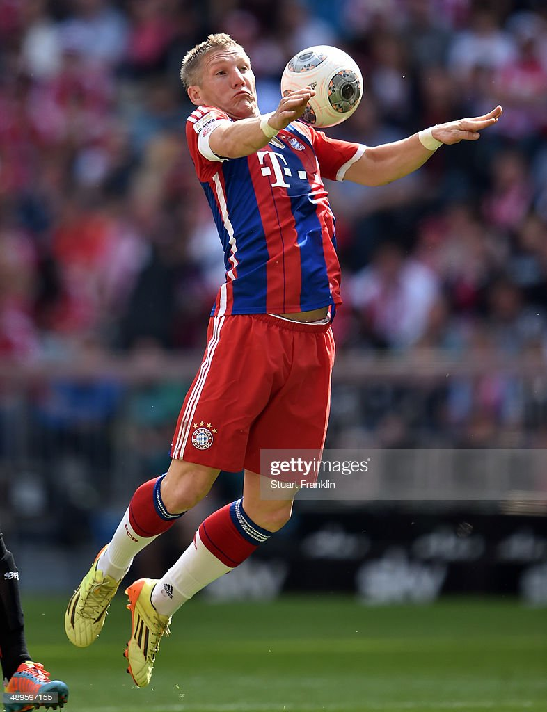 <a gi-track='captionPersonalityLinkClicked' href=/galleries/search?phrase=Bastian+Schweinsteiger&family=editorial&specificpeople=203122 ng-click='$event.stopPropagation()'>Bastian Schweinsteiger</a> of Muenchen in action during the Bundesliga match between Bayern Muenchen and VfB Stuttgart at Allianz Arena on May 10, 2014 in Munich, Germany.