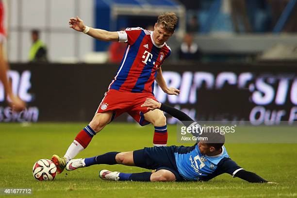 Bastian Schweinsteiger of Muenchen is challenged by Thiago Neves Augusto of AlHilal during the friendly match between Al Hilal and Bayern Muenchen on...