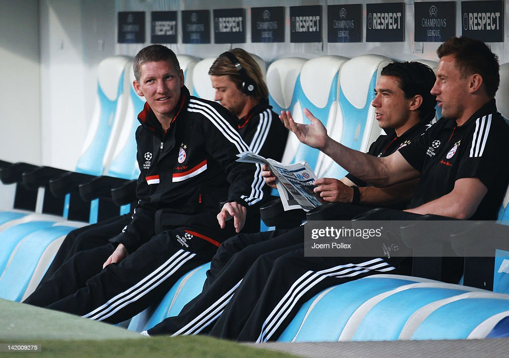 <a gi-track='captionPersonalityLinkClicked' href=/galleries/search?phrase=Bastian+Schweinsteiger&family=editorial&specificpeople=203122 ng-click='$event.stopPropagation()'>Bastian Schweinsteiger</a> (L) of Muenchen is seen on the bench prior to the UEFA Champions League Quarter Final first leg match between Olympique de Marseille and FC Bayern Muenchen at Stade Velodrome on March 28, 2012 in Marseille, France.