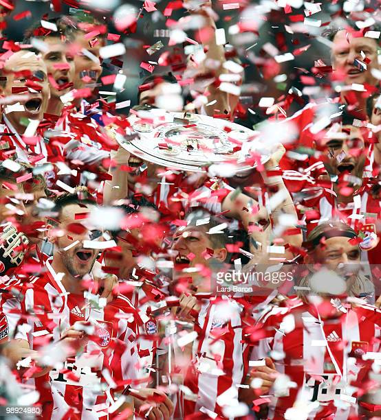 Bastian Schweinsteiger of Muenchen lifts the trophy after the Bundesliga match between Hertha BSC Berlin and FC Bayern Muenchen at Olympic Stadium on...