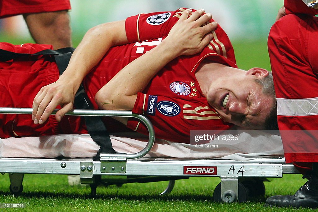 Bastian Schweinsteiger of Muenchen reacts as he lies on a stretcher during the UEFA Champions League group A match between FC Bayern Muenchen and SSC Napoli at Allianz Arena on November 2, 2011 in Munich, Germany.