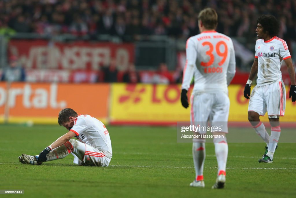 <a gi-track='captionPersonalityLinkClicked' href=/galleries/search?phrase=Bastian+Schweinsteiger&family=editorial&specificpeople=203122 ng-click='$event.stopPropagation()'>Bastian Schweinsteiger</a> (L) of Muenchen reacts with his team mates <a gi-track='captionPersonalityLinkClicked' href=/galleries/search?phrase=Toni+Kroos&family=editorial&specificpeople=638597 ng-click='$event.stopPropagation()'>Toni Kroos</a> (C) and Dante during the Bundesliga match between 1. FC Nuernberg and FC Bayern Muenchen at Easy Credit Stadium on November 17, 2012 in Nuremberg, Germany.