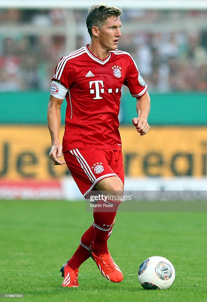 <a gi-track='captionPersonalityLinkClicked' href=/galleries/search?phrase=Bastian+Schweinsteiger&family=editorial&specificpeople=203122 ng-click='$event.stopPropagation()'>Bastian Schweinsteiger</a> of Muenchen runs with the ball during the DFB Cup first round match between BSV SW Rehden and Bayern Muenchen at osnatel Arena on August 5, 2013 in Osnabrueck, Germany.