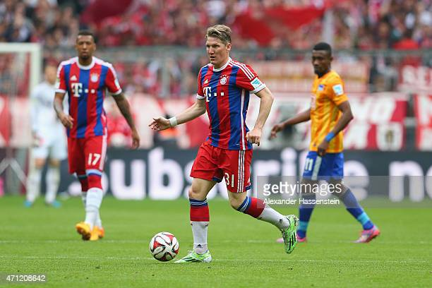 Bastian Schweinsteiger of Muenchen runs with the ball during the Bundesliga match between FC Bayern Muenchen and Hertha BSC Berlin at Allianz Arena...