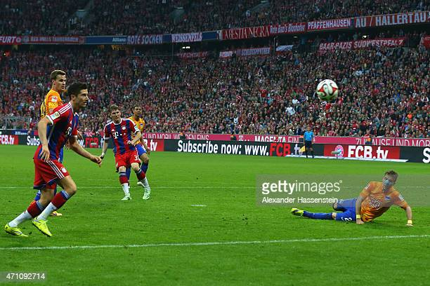 Bastian Schweinsteiger of Muenchen scores the opening goal during the Bundesliga match between FC Bayern Muenchen and Hertha BSC Berlin at Allianz...