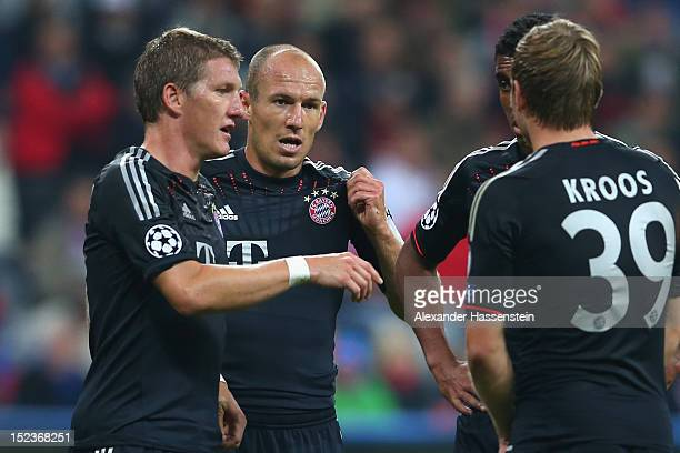 Bastian Schweinsteiger of Muenchen talks to his team mate Arjen Robben Luiz Gustavo and Toni Kroos during the UEFA Champions League group F match...
