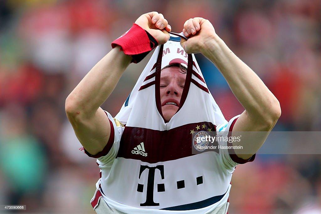 Bastian Schweinsteiger of Muenchenchanges his match jersey during the half time break of Bundesliga match between Sport Club Freiburg and FC Bayern Muenchen at Schwarzwald-Stadion on May 16, 2015 in Freiburg im Breisgau, Germany.