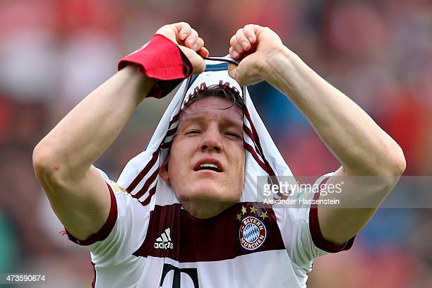 Bastian Schweinsteiger of Muenchenchanges his match jersey during the half time break of Bundesliga match between Sport Club Freiburg and FC Bayern...