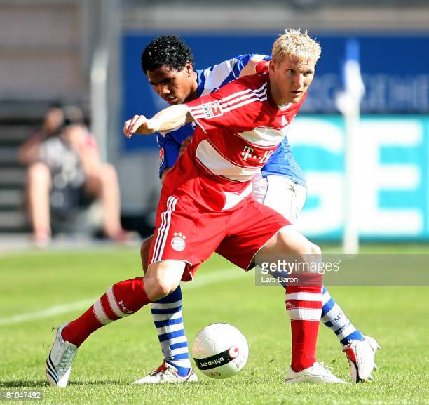 Bastian Schweinsteiger of Munich battles for the ball with Michael Lamey of Duisburg during the Bundesliga match between MSV Duisburg and Bayern...