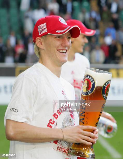 Bastian Schweinsteiger of Munich celebrates after the Bundesliga match between VfL Wolfsburg and Bayern Munich at the Volkswagen Arena on May 4 2008...