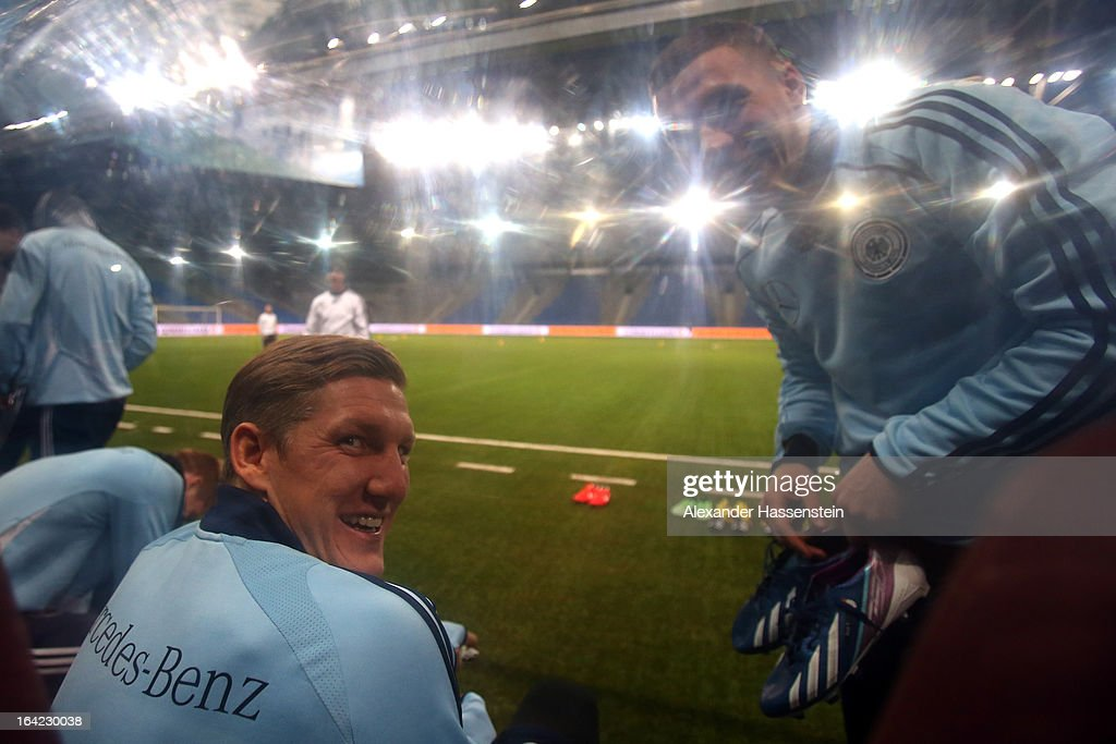 <a gi-track='captionPersonalityLinkClicked' href=/galleries/search?phrase=Bastian+Schweinsteiger&family=editorial&specificpeople=203122 ng-click='$event.stopPropagation()'>Bastian Schweinsteiger</a> (L) of the German national football team jokes with his team mate <a gi-track='captionPersonalityLinkClicked' href=/galleries/search?phrase=Lukas+Podolski&family=editorial&specificpeople=204460 ng-click='$event.stopPropagation()'>Lukas Podolski</a> (R) during a training session at Astana arena on March 21, 2013 in Astana, Kazakhstan.