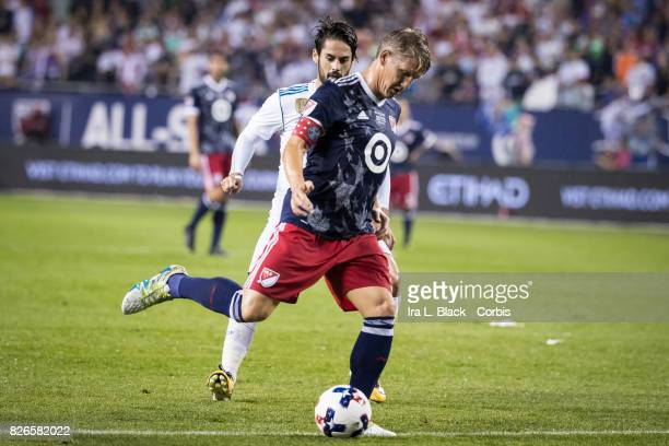 Bastian Schweinsteiger of the MLS AllStars keeps the ball away from Isco of Real Madrid during the MLS AllStar match between the MLS AllStars and...