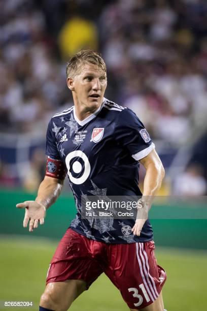 Bastian Schweinsteiger of the MLS AllStars looks for the pass from Tim Howard of MLS AllStars during the MLS AllStar match between the MLS AllStars...