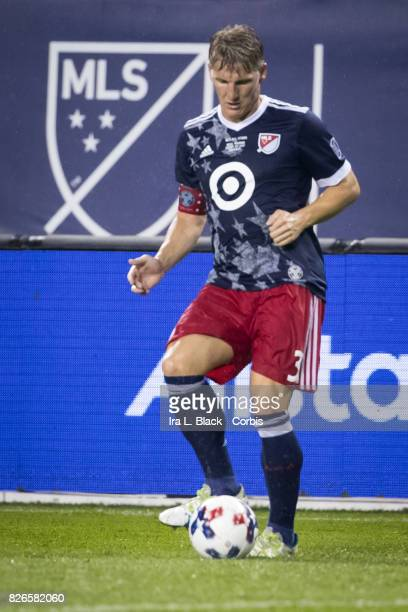 Bastian Schweinsteiger of the MLS AllStars passes the ball during the MLS AllStar match between the MLS AllStars and Real Madrid at the Soldier Field...