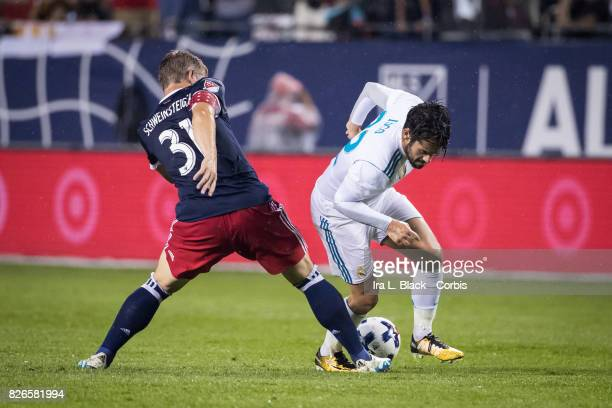 Bastian Schweinsteiger of the MLS AllStars steps in to take the ball away from Isco of Real Madrid during the MLS AllStar match between the MLS...