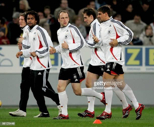 Bastian Schweinsteiger Patrick Owomoyela Fabian Ernst Miroslav Klose and Sebastian Deisler run during the training session of the German Football...