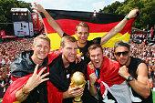Bastian Schweinsteiger Per Mertesacker Manuel Neuer Kevin Grosskreutz and Lukas Podolski celebrate on stage at the German team victory ceremony July...