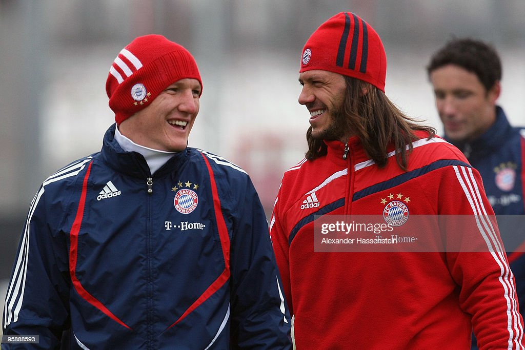 <a gi-track='captionPersonalityLinkClicked' href=/galleries/search?phrase=Bastian+Schweinsteiger&family=editorial&specificpeople=203122 ng-click='$event.stopPropagation()'>Bastian Schweinsteiger</a> (L) smiles with his team mate <a gi-track='captionPersonalityLinkClicked' href=/galleries/search?phrase=Martin+Demichelis&family=editorial&specificpeople=240330 ng-click='$event.stopPropagation()'>Martin Demichelis</a> during the Bayern Muenchen training session at Bayern's training ground 'Saebener Strasse' on January 20, 2010 in Munich, Germany.